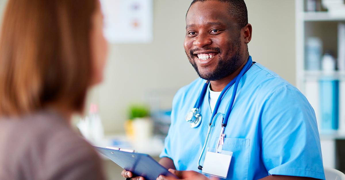Male nurse seeing patient