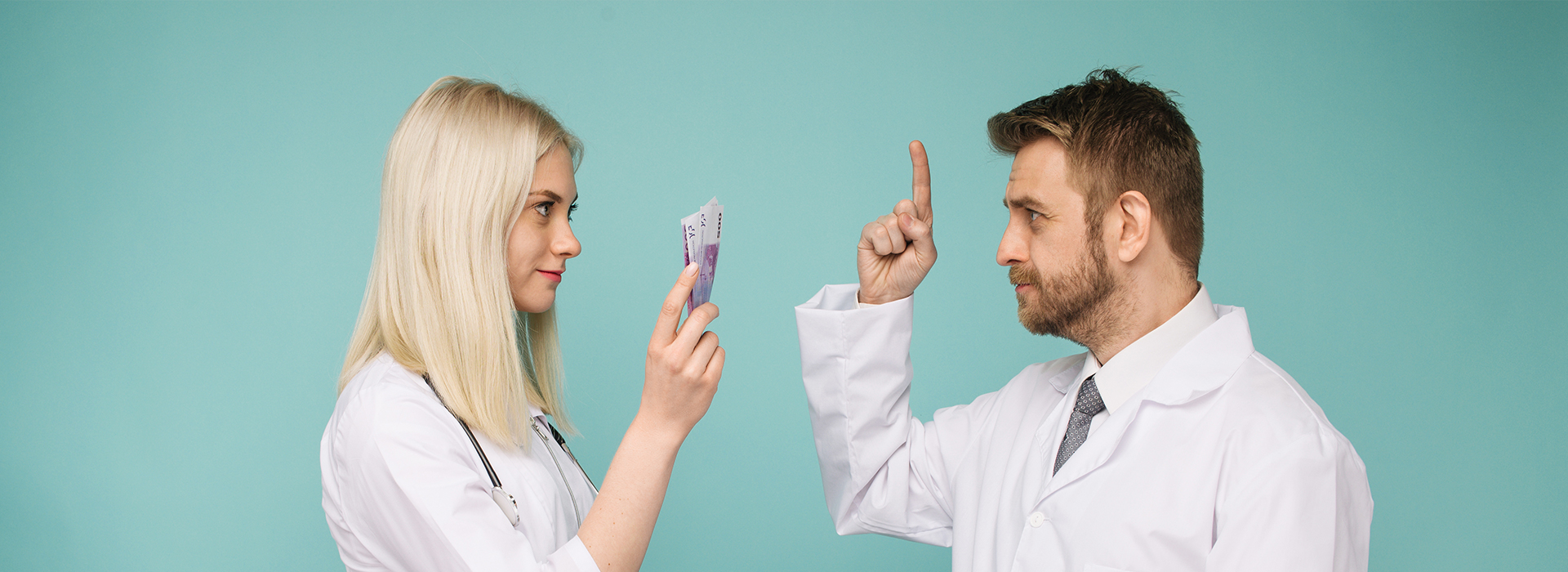 Female nurse and male nurse talking about gender pay gap